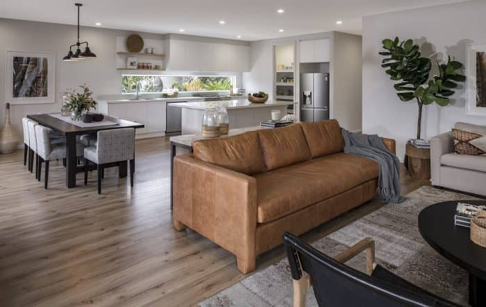 Open plan living, dining and kitchen areas in the Brooklyn display home with Breeze Façade at Warwick Farm. | knock down rebuild a new home